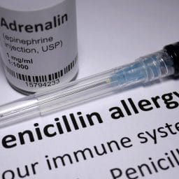 Penicillin Allergy note and an anaphylactic shock needle