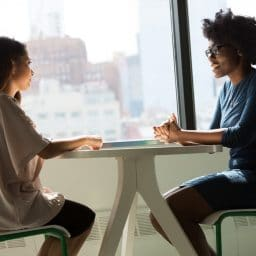 Two women having a conversation.